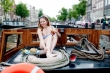 model drinks a bloody mary on G's boat